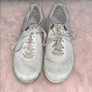 rose gold nike shoes